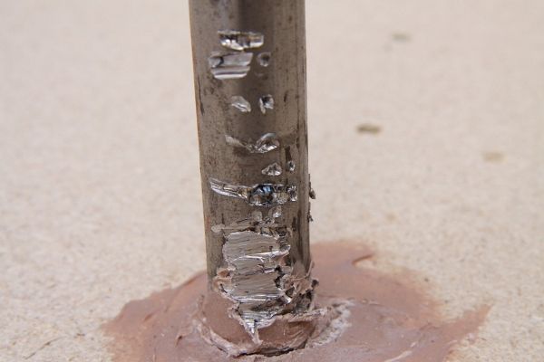 BrushDestructor Heavy Duty blade test as specified to Australian Standards 3575 1995 - Close up of steel bar after two impacts